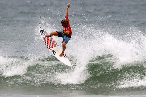 Pictured: Billabong team rider Shaun Joubert (Mossel Bay), 18, successfully boosts a hands free aerial to win the Quiksilver Pro Junior and R19 000 at North Beach in Durban on Sunday Photo: Greg Ewing