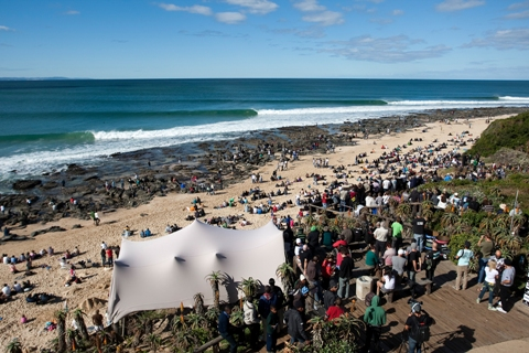 Spectators watch the world's best surfers in the world's best waves at the Billabong Pro J-Bay at Supertubes, Jeffreys Bay