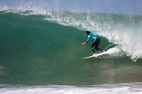 Pictured: Sean Holmes displays his tube riding prowess at Supertubes on Day 1 of the Billabong Pro J-Bay 2010. The Cape Town based wildcard won his Round 2 heat and will be up against Kelly Slater (USA), the top seed and 9 x ASP World Champion, in Round 3. Image Credit:  Karen / Billabong
