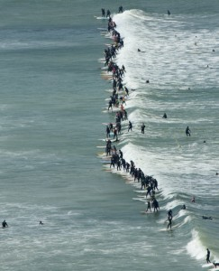 110 surfers successfully ride the same wave at the Earthwave Beach Festival on Muizenberg Beach last year to set a new Guinness World Record  Photo: Craig Parker
