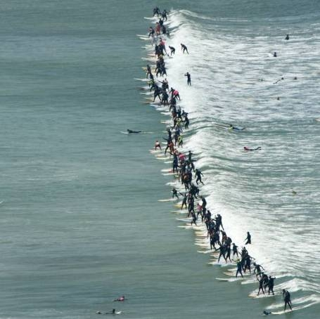 Pictured: 110 surfers successfully ride the same wave at the Earthwave Beach Festival on Muizenberg Beach last year to set a new Guinness World Record. Photo: Craig Parker