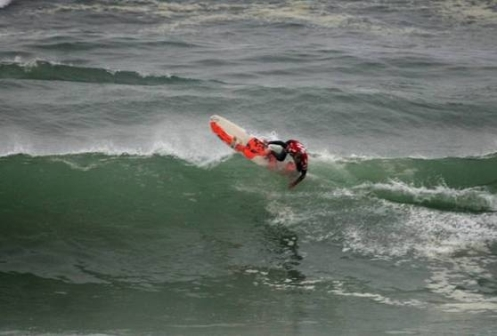 Pictured: SA's Matthew Moir banks off the top of of an overhead wave on his way to victory in his Round 1 Longboard heat at the 2010 Billabong ISA World Surfing Games in Peru on Thursday. Photo: ISA / Le Torre