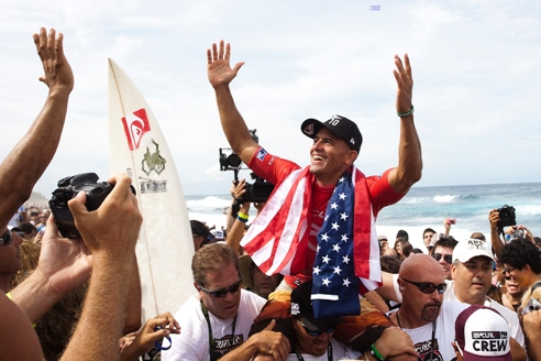 Pictured: Kelly Slater (USA), 38, is carried from the water's edge to the podium after clinching an unprecedented 10th ASP World title in Puerto Rico on Saturday. Slater went on to win the Rip Curl Pro Search event  Credit: ASP/Cestari