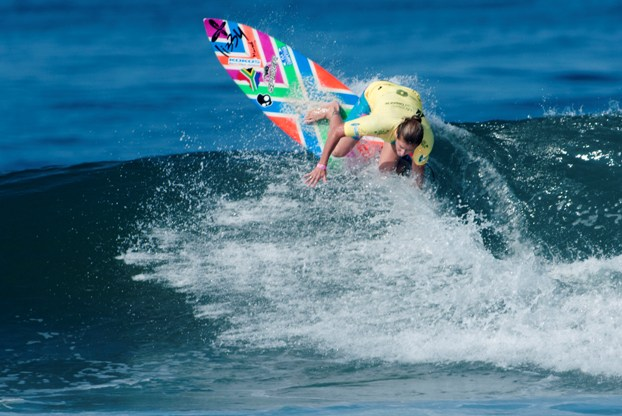 Heather Clark (Port Shepstone) carves off the top of a wave at Montanita in Ecuador yesterday (Friday). Clark is now just one heat away from a medal in the Women's Masters division at the 2013 ISA World Masters Surfing Championships  Photo: ISA / Rommel Gonzales