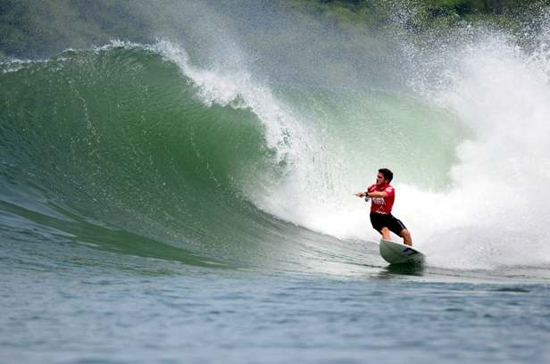Davey Brand carves off the bottom of an overhead wave on Day 1 of the 2013 Reef ISA World Surfing Games in Panama. Photo: ISA / Tweddle