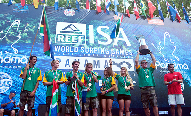 Team South Africa celebrate their ISA World Team Champions title on the podium at the 2013 Reef ISA World Surfing Games in Panama with their gold medals, the Fernando Aguerre World Team Champions Trophy and IOC President's Trophy. (From left to right) Mikey February, David van Zyl, Davey Brand, Men's ISA World Champion Shaun Joubert (Capt), Tanika Hoffman, Faye Zoetmulder, Etienne Venter.  Photo: ISA / Tweddle