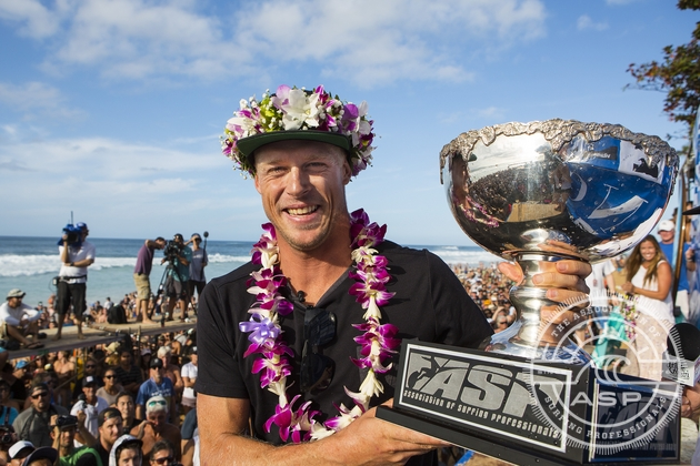 Mick Fanning (AUS), 32, with his third ASP World Championship Title trophy  Credit: ASP / Kirstin