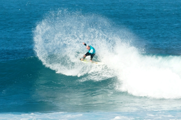 A competitor throws a sheet of spray as he carves a cutback in the ideal conditions and pumping waves at Nahoon Reef on Day 2 of the 2014 Cool Shoe SA Masters Surfing Championships  Photo: Graeme Field