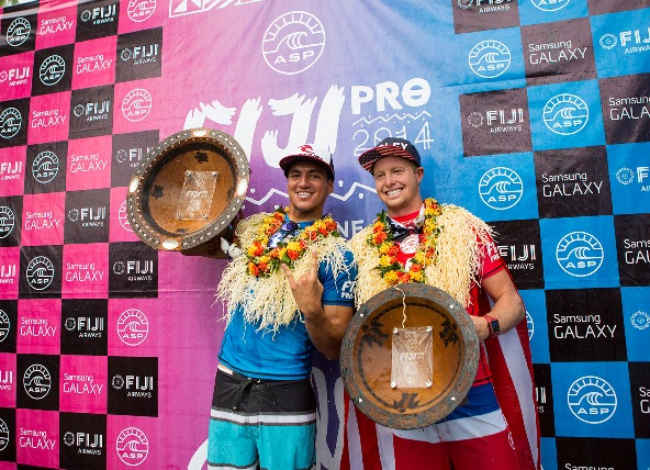 Gabriel Medina (BRA) celebrates his victory at the Fiji Pro with runner-up Nat Young (USA)  Credit: ASP / Kirstin