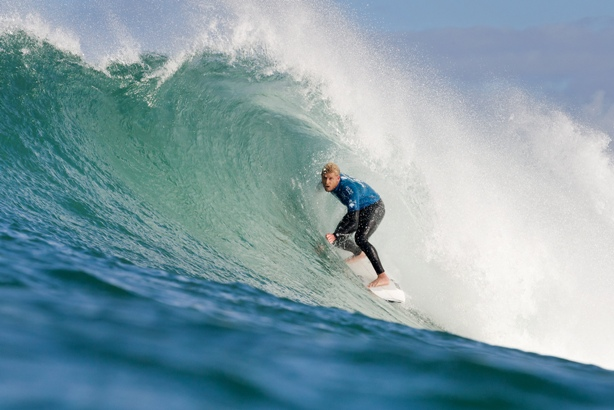 Mick Fanning (AUS) tucks into a tube at Supertubes in Jeffreys Bay on his way to victory in the J-Bay Open on Saturday Credit: ASP / Cestari
