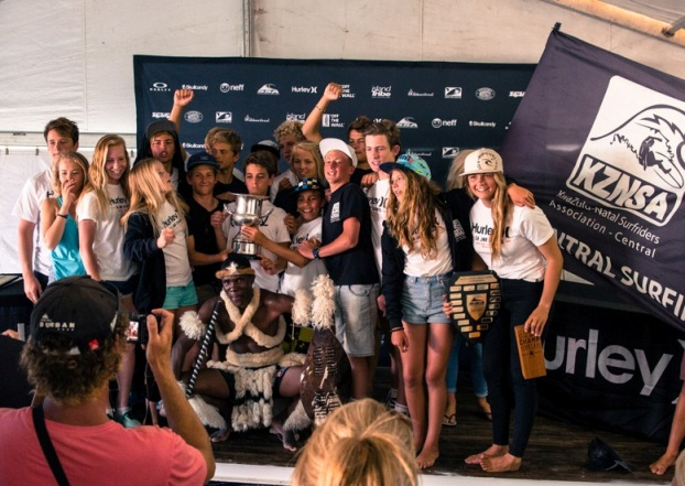 The KwaZulu-Natal Central team celebrate winning the Freedom Cup at the 2014 Hurley SA Junior Champs at Jeffreys Bay along with their talisman, Zulu warrior Bonginkosi Ntuli  Photo: Alan van Gysen