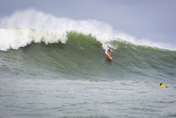 Nic Lamb (USA) drops down the face of massive wave on his way to victory in the Punta Galea Challenge in the Basque region of Spain on Thursday  Image: ASP / Poullenot