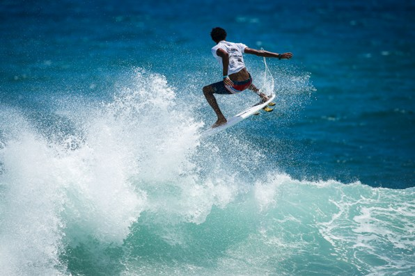 Michael February takes to the air with the 'Hail Mary' 360 backhand aerial that earned him a spot in the Final of the Martinique Surf Pro.  Image: (c) WSL / Poullenot
