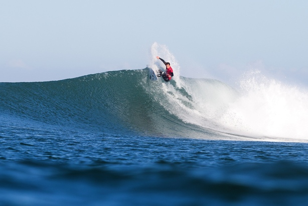 Julian Wilson rides the only wave in the final of the J-Bay Open before it was called off after a shark attack on his opponent Mick Fanning  Photo: WSL / Cestari