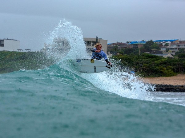 Adin Masencamp (Cape Winelands) carves a powerful turn off the lip of a Jeffreys Bay wave on the opening day of the Billabong SA Junior Champs Photo: (c) Alan van Gysen