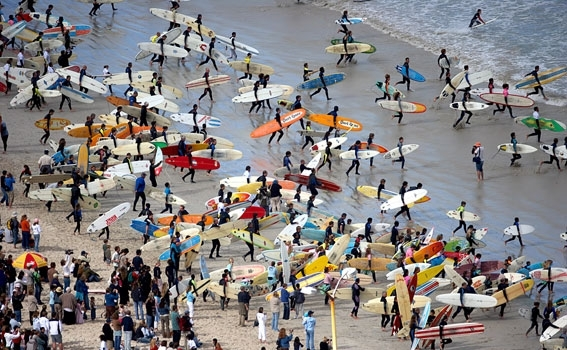 Hundreds of surfers of all ages and abilities heading out for an attempt to set a new record for the 'Most Surfers Riding the Same Wave' at a previous Earthwave Beach Festival  Photo: Earthwave