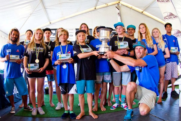 The victorious Cape Town Surfriders team hold aloft the coveted Freedom Cup that they won for accumulating the highest points total at the Billabong SA Junior Champs at Jeffreys Bay  Photo: (c) Ian Thurtell