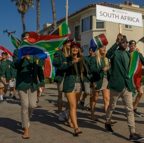 The 2015 South Africa Junior Surfing Team marching in the Parade of Nations, part of the opening ceremonies for the VISSLA ISA World Junior Championships in Oceanside California on Sunday  Photo: ISA / Sean Evans
