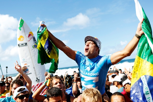 Adriano De Souza carried up the beach after clinching the 2015 WSL Title Photo: WSL / Kirstin