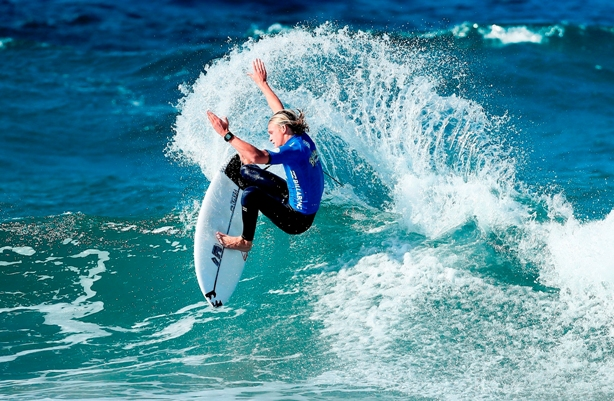 Adin Masencamp (Strand) throws an arc of spray on his way to victory in the premier U18 Boys' division of the Billabong Junior Series at Willard Beach in Ballito on Saturday Photo: Kelly Cestari