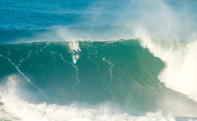Grant 'Twiggy' Baker from Durban drops into a giant wave on his way to seventh place in the first WSL BWT Nazaré Challenge in Portugal on Tuesday Image: WSL / Masurel