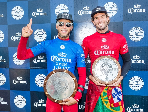 Filipe Toledo (BRA, left) and Frederico Morais (PRT) celebrate on the podium at the Corona Open J-Bay in Jeffreys Bay on Thursday Photo: WSL / Cestari